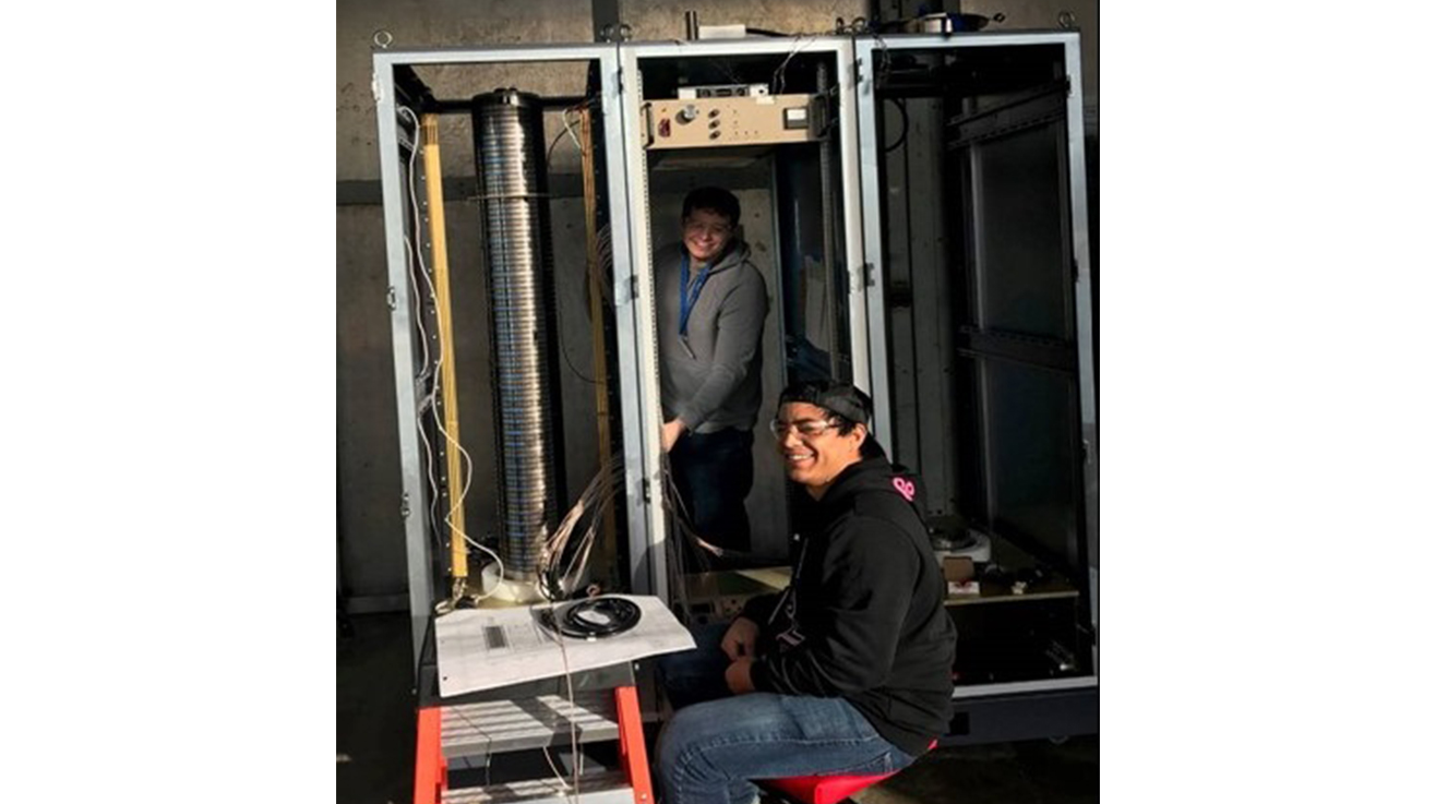 Principal Engineer Michael Misch (background) continues build on unit cabinets at LLNL with Engineer Koby Sugihara (foreground).
